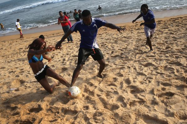 Youth play soccer on 'Miami Beach' in Monrovia, Liberia on Jan. 25, 2015.