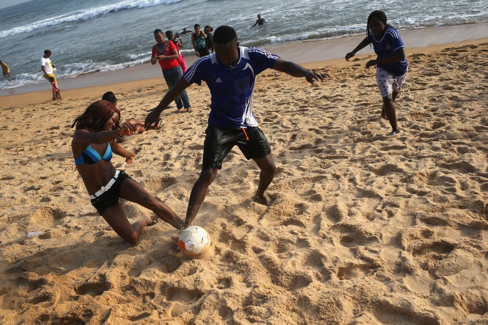 Youth play soccer on 'Miami Beach' in Monrovia, Liberia on Jan. 25, 2015.