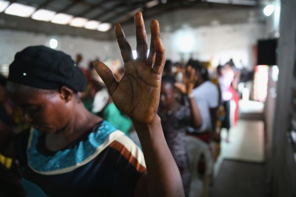 A congregation prays during a Sunday service at the Bethel World Outreach Church in the West Point township in Monrovia, Libe