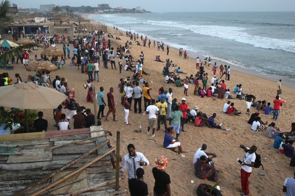 Liberians socialize on 'Miami Beach' in Monrovia, Liberia on Jan. 25, 2015.