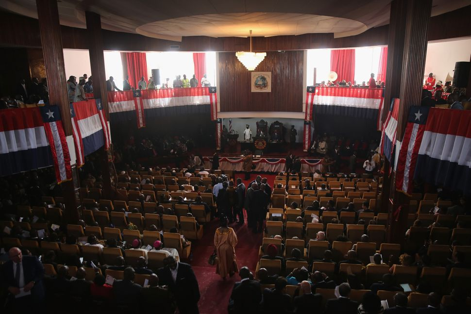 Lawmakers and guests gather to hear Liberian President Ellen Johnson Sirleaf deliver her State of the Nation address to a joi