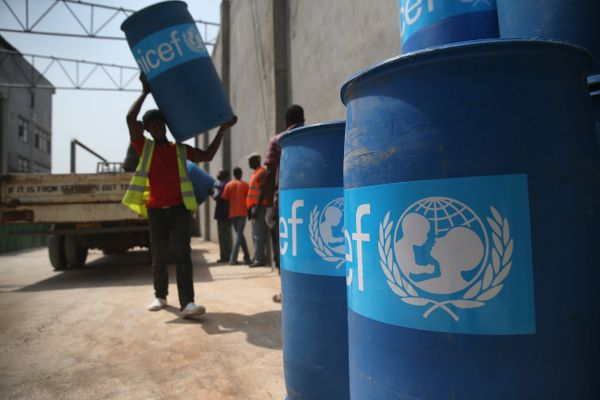 UNICEF workers assemble 'school infection prevention kits' in Monrovia to stop the spread of Ebola in schools on Jan. 28, 201