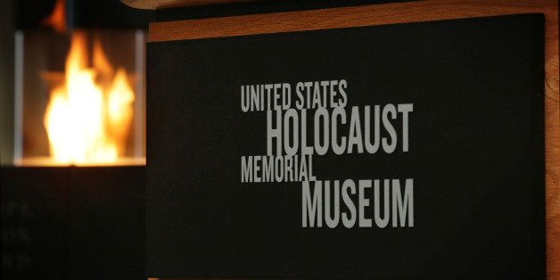WASHINGTON, DC - JANUARY 27:  An eternal flame is lit in the Hall of Remembrance during an International Holocaust Remembranc