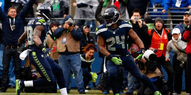 SEATTLE, WA - JANUARY 18:  Marshawn Lynch #24 of the Seattle Seahawks gestures after scoring a touchdown against the Green Ba