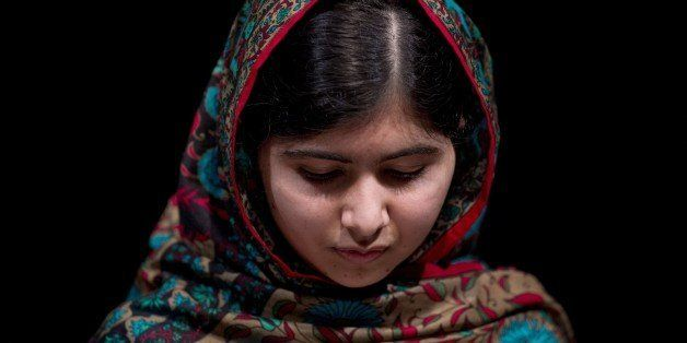 Pakistani rights activist Malala Yousafzai addresses the media in Birmingham, central England on October 10, 2014. The Nobel