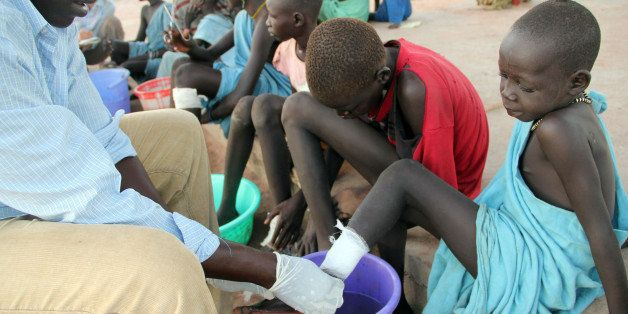 **  TO GO WITH SUDAN CARTER GUSANO   **  In this Nov.  4, 2010 photo, Ajak Kuol Nyamchiek, 7, watches while John Lotiki, a nu