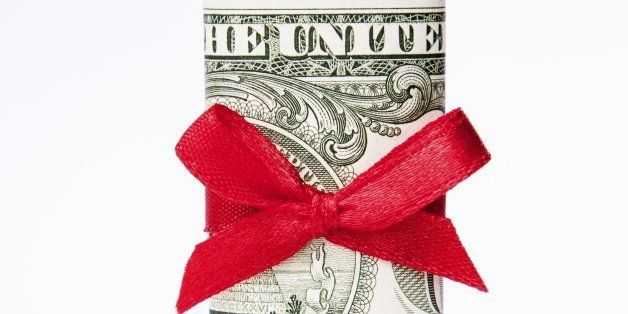 one dollar bill wrapped with a red bow