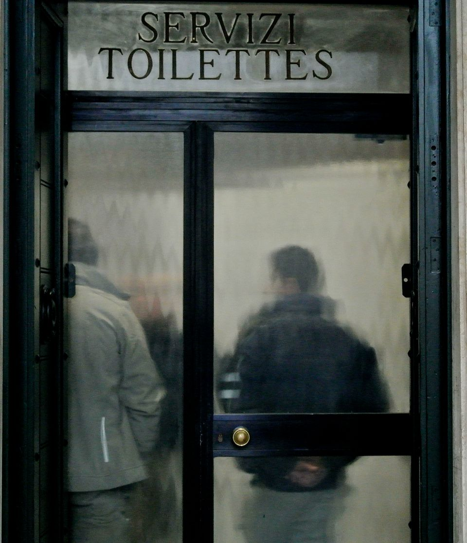 Workers stand near the main entrance of the public restrooms just off St. Peter's Square at the Vatican, Friday, Feb. 6, 2015