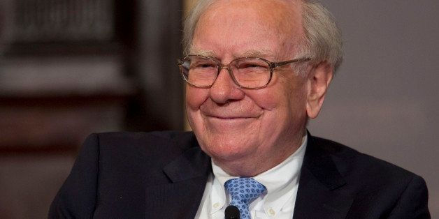 Warren Buffett, chairman and chief executive officer of Berkshire Hathaway Inc., smiles during a conversation with Brian Moyn