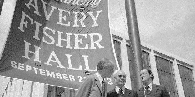 Avery Fisher, center, founder of Fisher Radio, stands in front of the former philharmonic hall in New York Lincoln center on