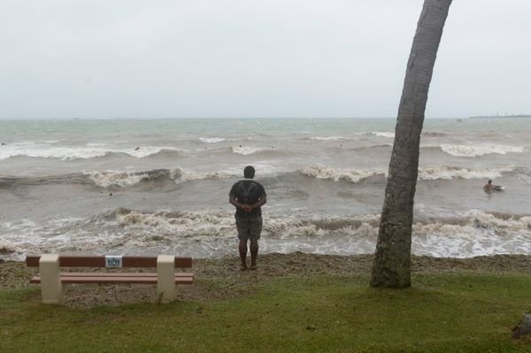 A man looks at the ocean in Anse Vata, south of Noumea, New Caledonia