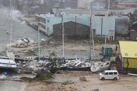 Damage is visible in Port Vila, Vanuatu, Sunday, March 15, 2015 after Tropical Cyclone Pam ripped through through the pacific