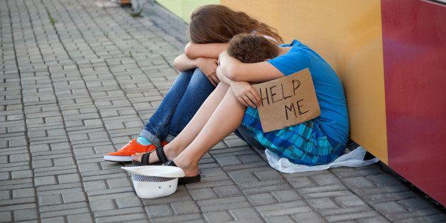 homeless teenage boy and girl...