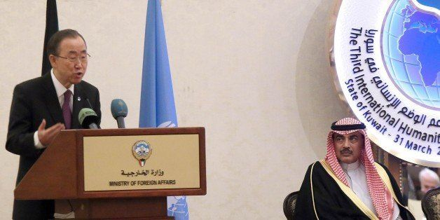 Kuwaiti Foreign Minister Sheikh Sabah al-Khaled al-Sabah (R) looks on as UN-Secretary General Ban Ki-moon speaks during the Third International Humanitarian Pledging Conference for Syria on March 30, 2015 in Kuwait City. AFP PHOTO / STR (Photo credit should read STR/AFP/Getty Images)