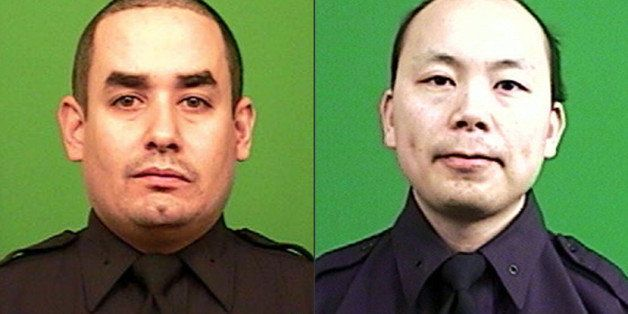 FILE - This combination made from photos provided by the New York Police Department shows officers Rafael Ramos, left, and We