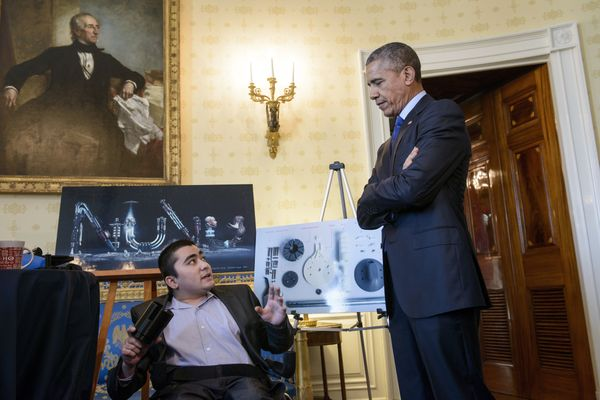 Mohammed Sayed of Cambridge, Massachusetts, speaks to President Barack Obama about his modular 3D-printed and magnet-based wh