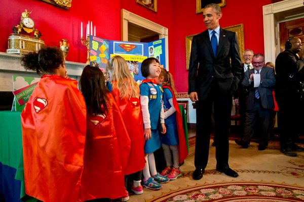 President Barack Obama tours an exhibit with 6-year-old Girl Scouts from Tulsa, Oklahoma, during the White House Science Fair