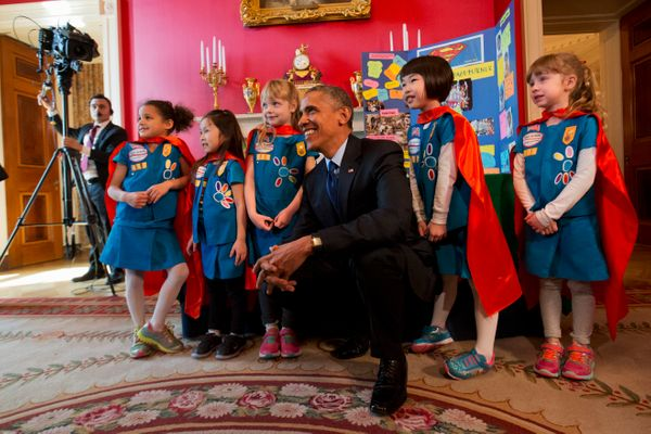President Barack Obama poses with 6-year-old Girl Scouts from Tulsa, Oklahoma, during the White House Science Fair.