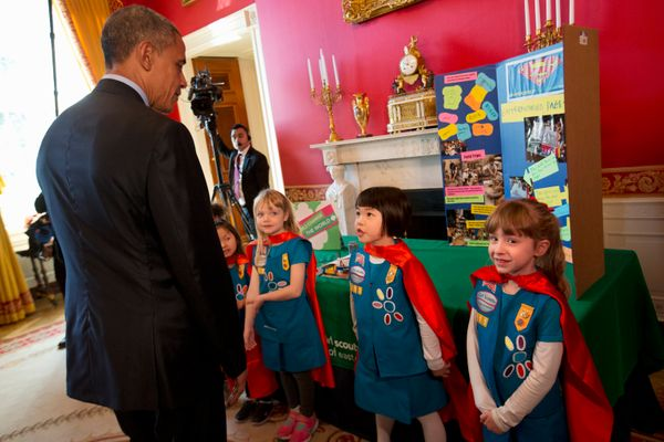 President Barack Obama tours an exhibit by 6-year-old Girl Scouts during the White House Science Fair.