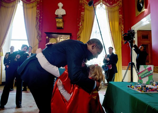 President Barack Obama receives a hug from Girl Scouts from Tulsa, Oklahoma, during the 2015 White House Science Fair.