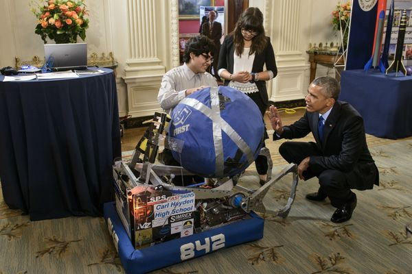 Sergio Corral and Isela Martinez, both of Phoenix, Arizona, explain their robot to President Barack Obama.