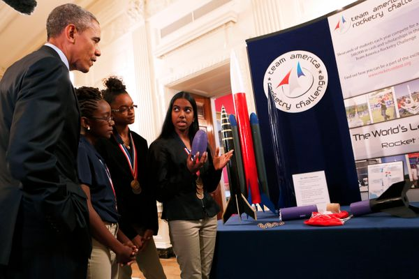 President Barack Obama listens to Stephanie Bullock, who is part of a team from the U.S. Virgin Islands that designed rockets