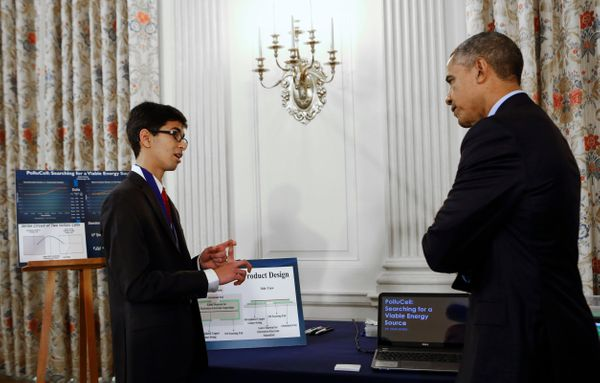 President Barack Obama listens to Sahil Doshi, 14, from Pittsburgh, Pennsylvania, who designed an innovative carbon-dioxide p
