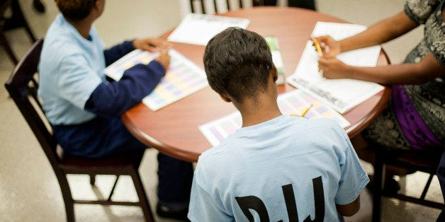 Juvenile residents sit at a table in a new career guidance center at the Department of Juvenile Justice's Metro Regional Yout