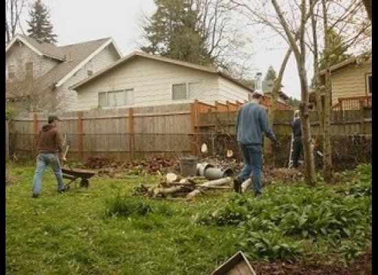 Volunteers take down trees, plant blackberry bushes and till a garden for their neighbors.
