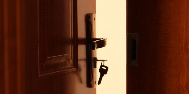 The door is openning,a key is inserted in lock.
