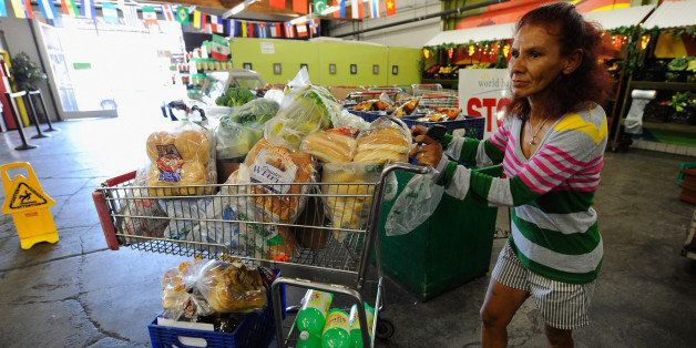 LOS ANGELES, CA - SEPTEMBER 17:  Norma Lopez pushes cart full of groceries out the World Harvest food bank on September 17, 2