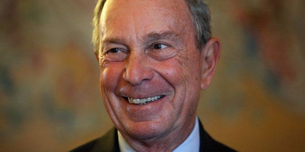 FILE - In this Sept. 16, 2014, file photo, former New York Mayor Michael Bloomberg smiles prior to be conferred with the Chev