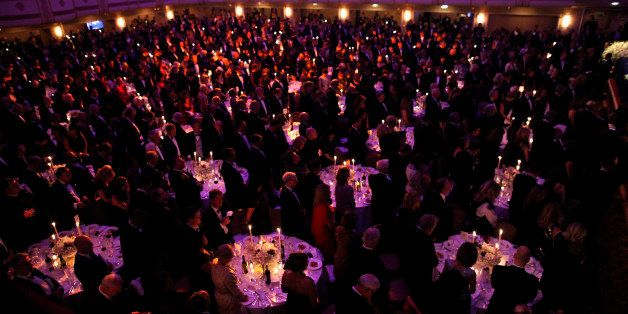 Audience members stand at the 67th annual Alfred E. Smith Memorial Foundation Dinner, a charity gala organized by the Archdio
