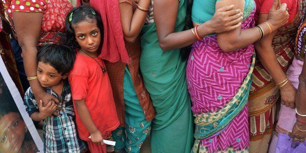 The children of Indian sex workers look on as they participate in a rally at the Sonagachi area of Kolkata on November 8, 201