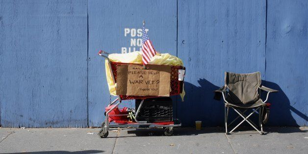 NEW YORK - NOVEMBER 11:  A homeless person's grocery cart and chair is shown along Fifth Avenue during the annual Veterans Da