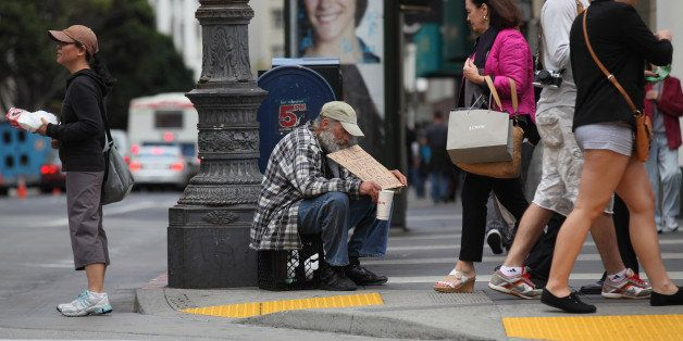 SAN FRANCISCO - SEPTEMBER 16:  A homeless man holds a sign as he panhandles for spare change on September 16, 2010 in San Fra