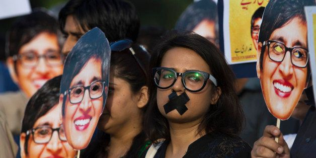 Supporters of prominent women's rights activist Sabeen Mahmud, who was killed by unknown gunmen, hold her pictures during a r