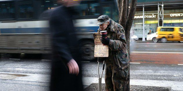 A homeless man begs for donations outside a subway station in New York on February 4, 2015. New York may be famous abroad for
