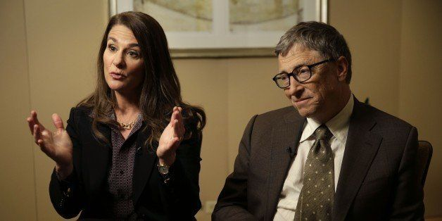 Bill Gates listens while his wife Melinda Gates talks during an interview in New York, Wednesday, Jan. 21, 2015. As the world