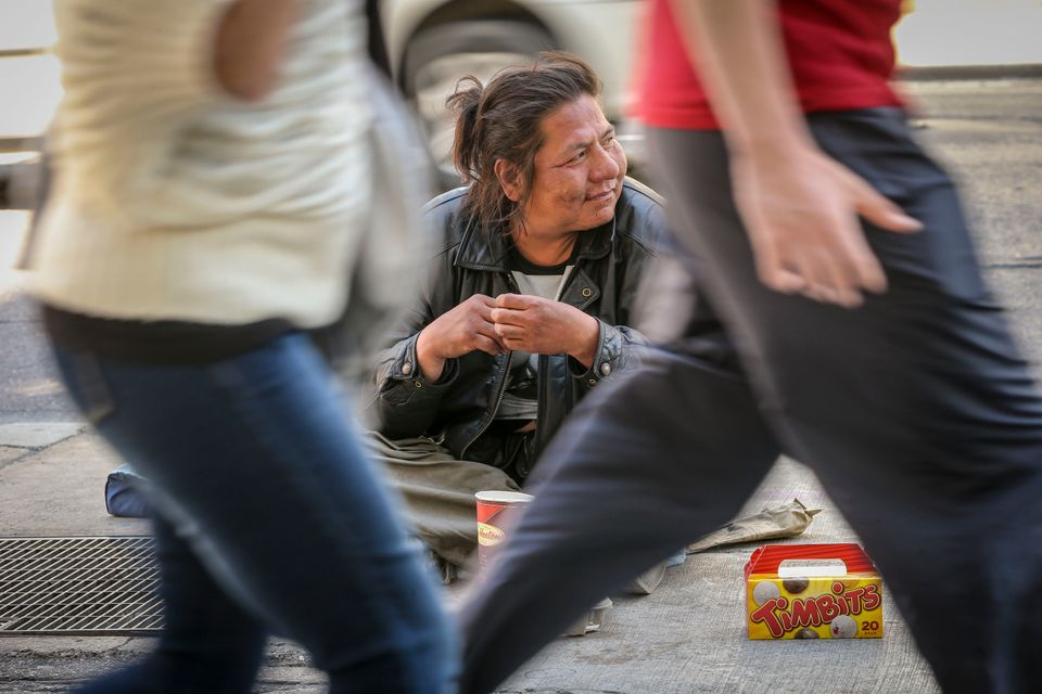 Michael Manitowabie 42, panhandles on his corner in downtown Toronto as he has done (according to him) for 20 years.