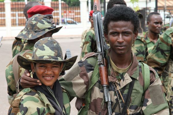In this photo, taken on 27 March 2013, young soldiers from the Seleka rebel alliance pose for a photo as they stand amidst th