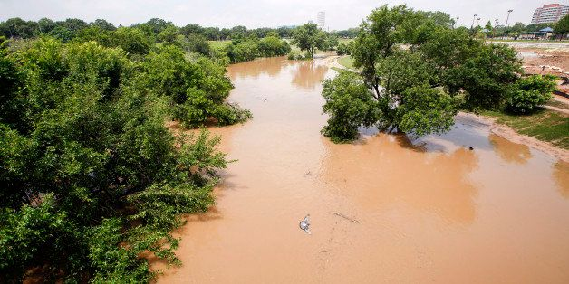 HOUSTON, TX - MAY 27:  Trees are submerged at Buffalo Bayou park after massive flooding May 27, 2015 in Houston, Texas. At le