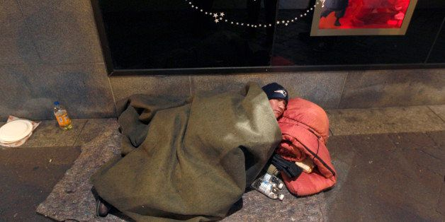 In this Monday night Dec. 12, 2011 photo, John Filliger, of Houston, who said he has been homeless for the past five years, l