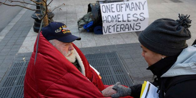 In this Wednesday, Nov. 20, 2013 photo homeless Korean War veteran Thomas Moore, 79, left, speaks with Boston Health Care for