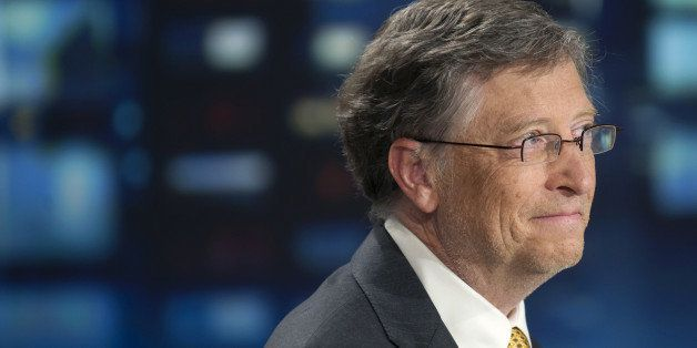 Microsoft founder and philanthropist Bill Gates smiles on the set of the TF1 TV channel in Paris on April 4, 2011, before an