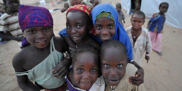 In this picture taken on January 26, 2015 a Nigerian refugee children pose for a photograph at a United Nations High Commissi