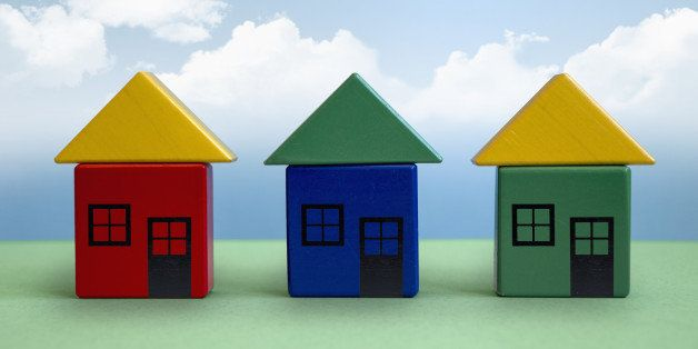 Three houses made from toy blocks