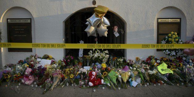 A morning view of a memorial outside the Emanuel AME Church June 19, 2015 in Charleston, South Carolina. US police arrested a