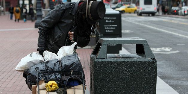 SAN FRANCISCO - JANUARY 25:  A homeless man named Joe looks for recyclables in a trash can on Market Street January 25, 2010