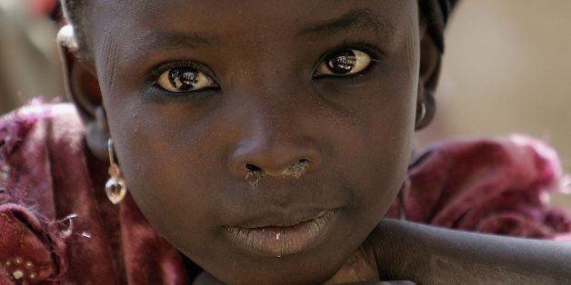 KANO, NIGERIA - NOVEMBER 29: A local girls is seen in Dawakin Kudu village on November 29, 2006 near Freetown, Sierra Leone.